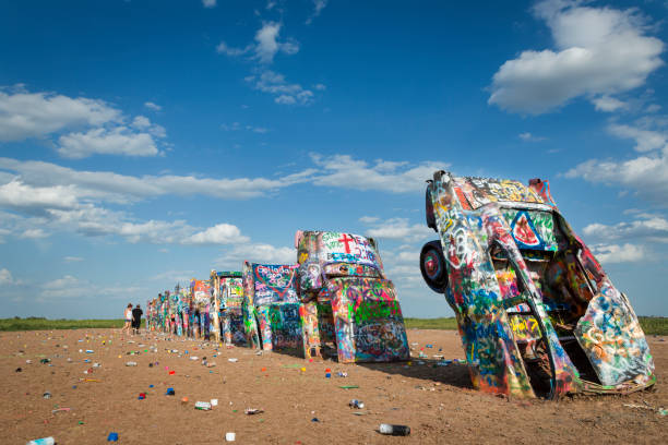 Row of brightly painted Cadillacs in the Cadillac Ranch in Amarillo, Texas, USA. stock photo