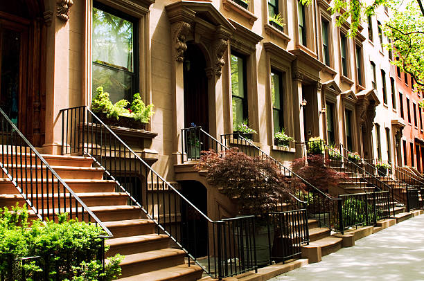 row of brownstones,nyc. - terraced houses stock photos and pictures