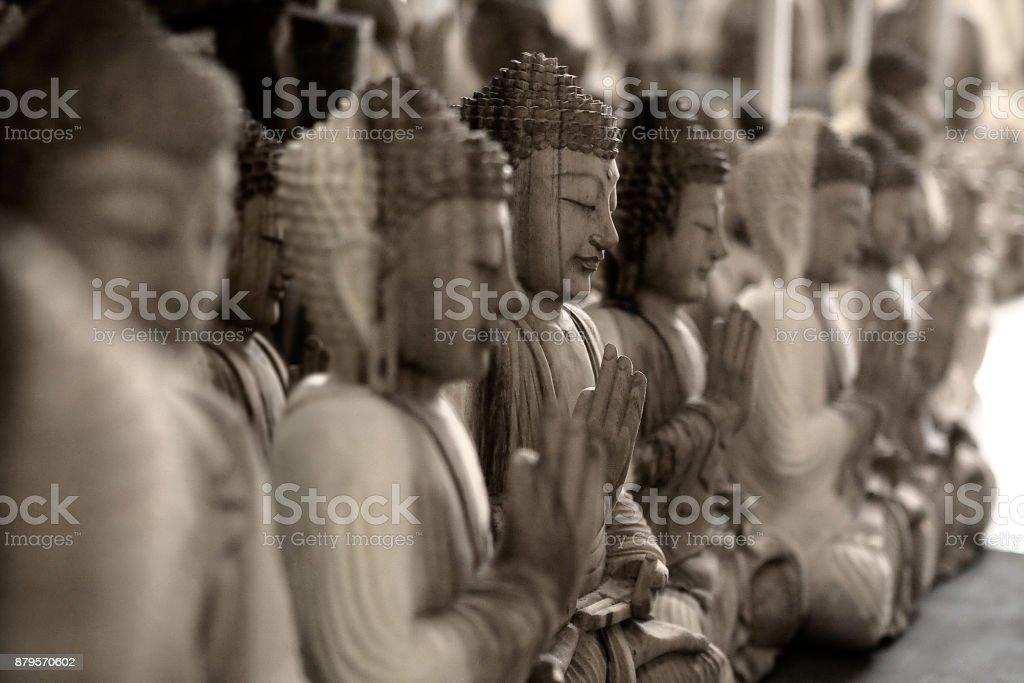Row of buddah statues stock photo