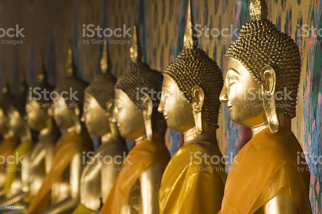 Row of Buddhas at Wat Arun in Bangkok, Thailand. stock photo