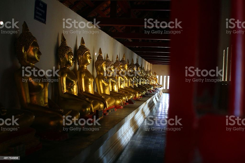 Row of Buddhas  in Bangkok, Thailand stock photo