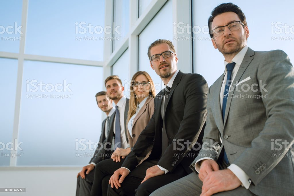 Row of business people waiting for an interview stock photo