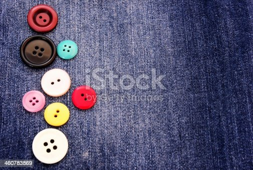 537376226istockphoto row of buttons on a dark blue jeans background 460783869