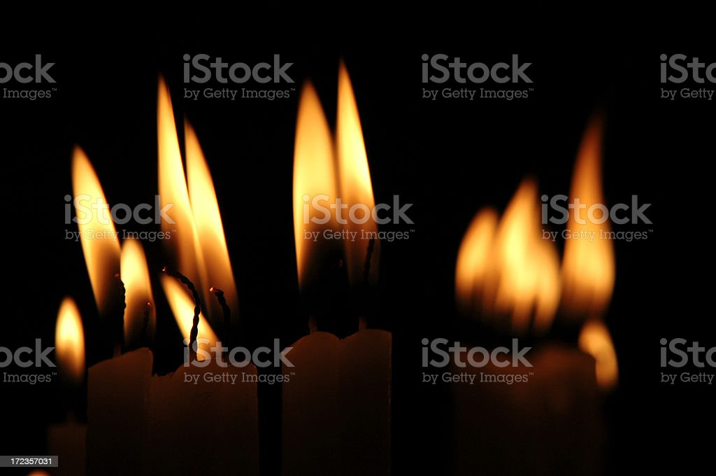 Row of Candle Flames Close Up on Black royalty-free stock photo