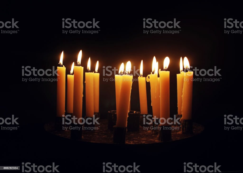 Row of candles in cathedral. stock photo