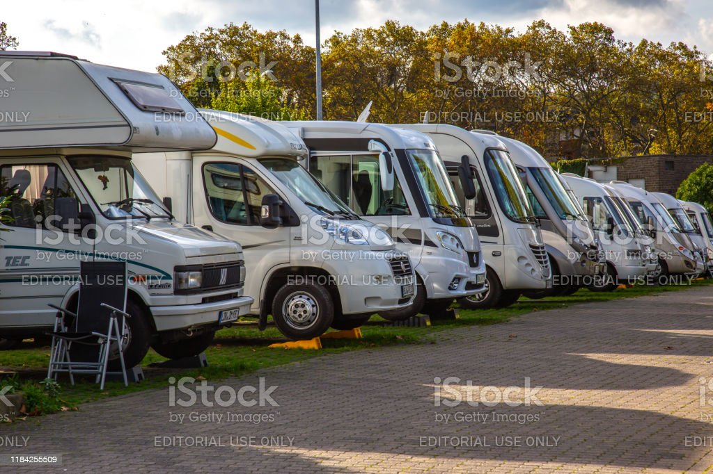 row of caravan vans on a camp ground Andernach, Rhineland Palatinate, Germany - October 25,2019: row of caravan vans on a camp ground Adventure Stock Photo