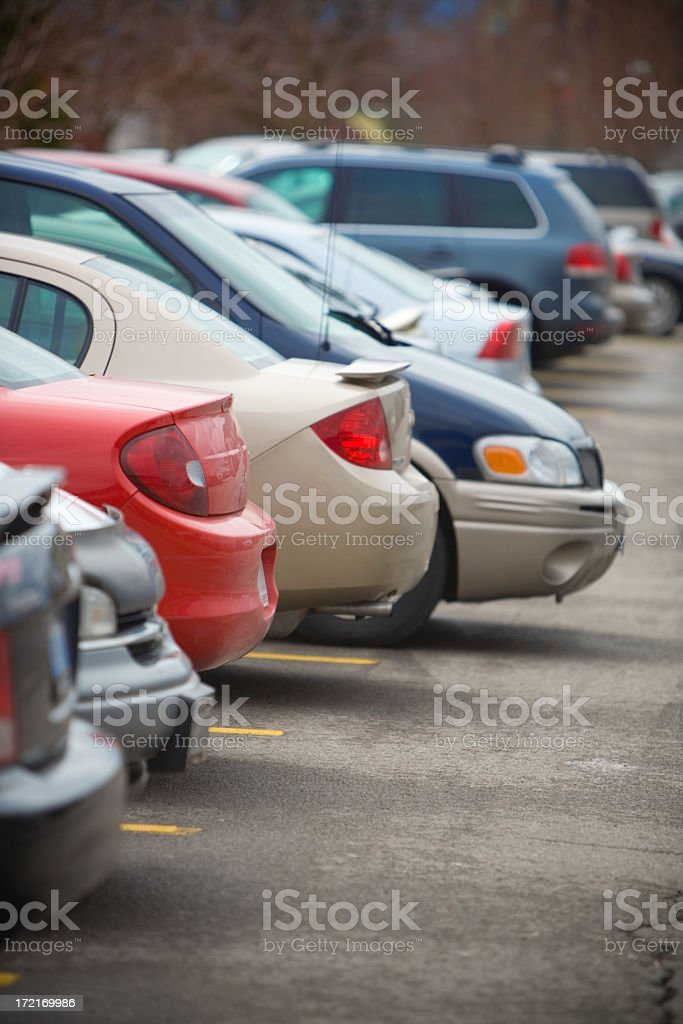 Row of cars parked in a parking lot royalty-free stock photo