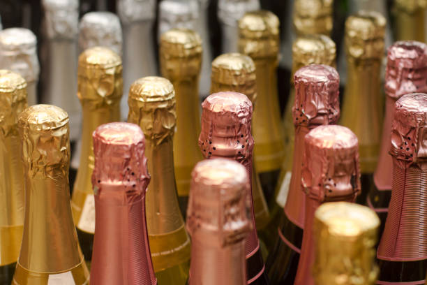 row of champagne bottles stock photo