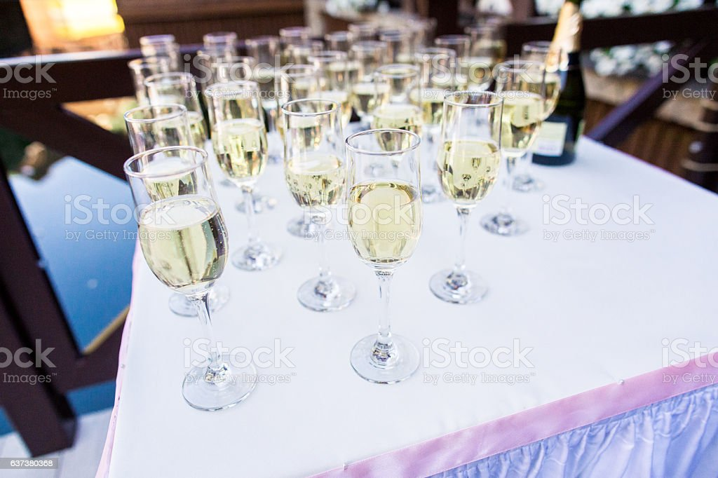 row of champagne glasses stock photo