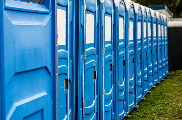 Row of chemical and portable toilets Row of blue chemical and portable toilets for an outdoor party portable toilet stock pictures, royalty-free photos & images