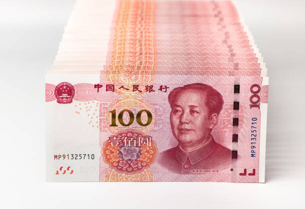 Row of Chinese yuan banknotes close up. Row of Chinese yuan banknotes close up. chinese currency stock pictures, royalty-free photos & images