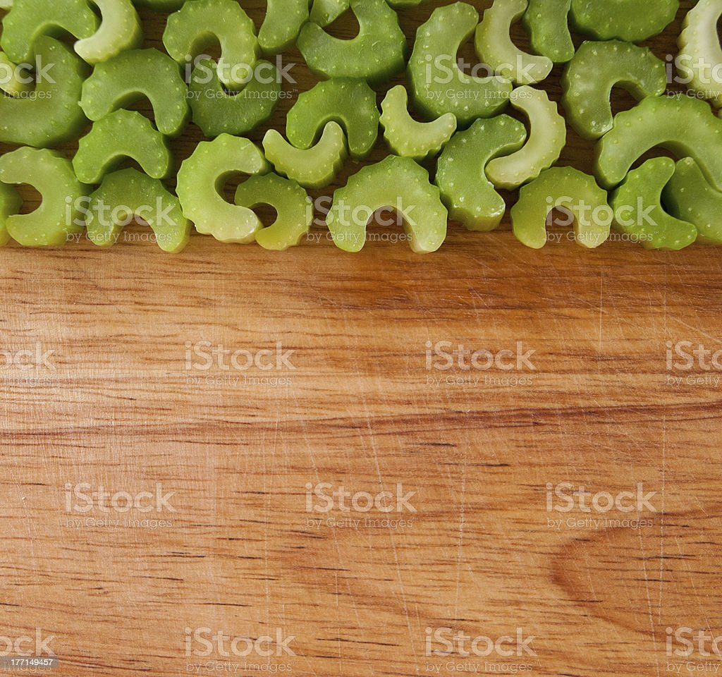 Row of chopped celery pieces against wood royalty-free stock photo