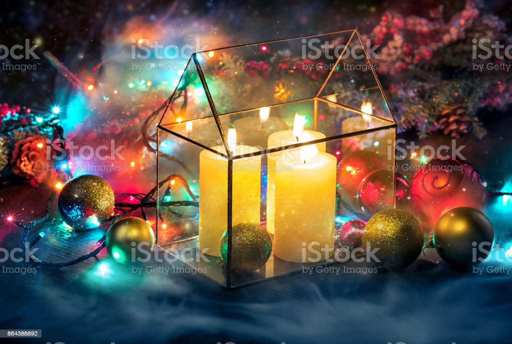 Row of christmas candles on red background stock photo