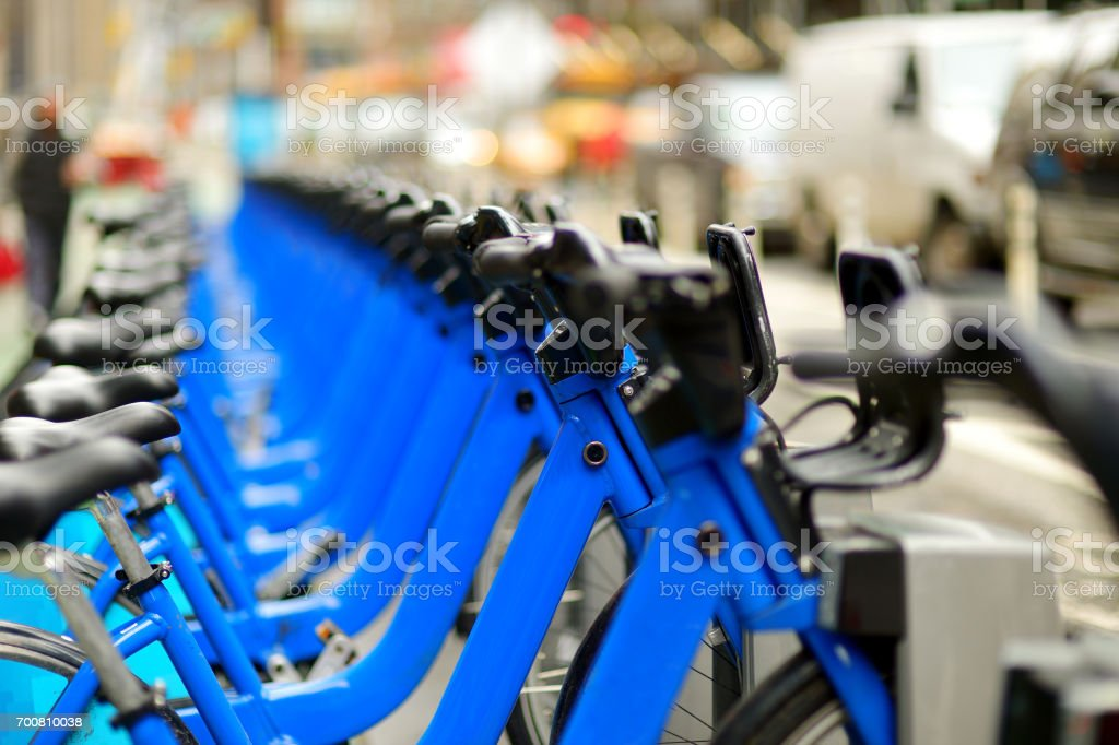 Row of city bikes for rent at docking stations in New York stock photo