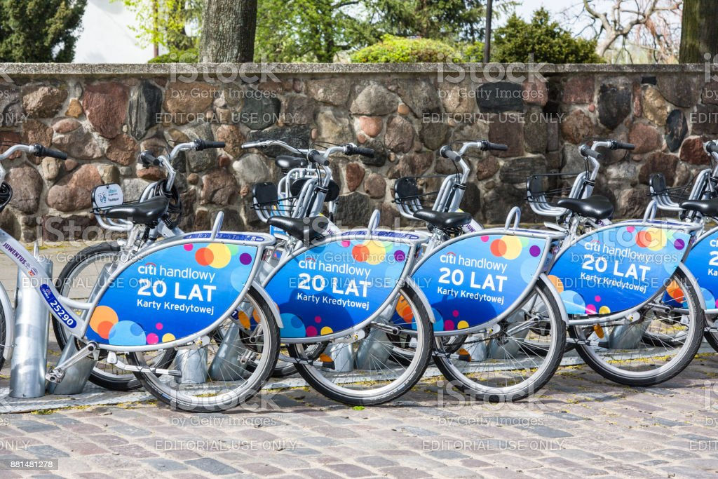 Row of city bikes for rent at docking stations in Old town, Warsaw stock photo
