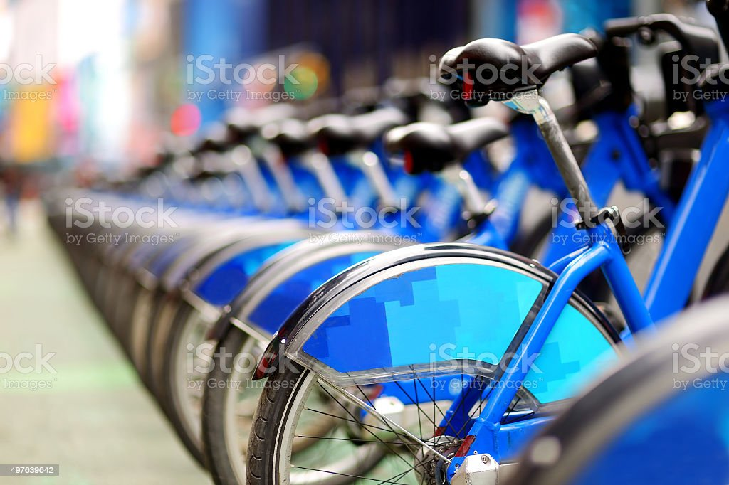 Row of city bikes for rent at docking stations stock photo