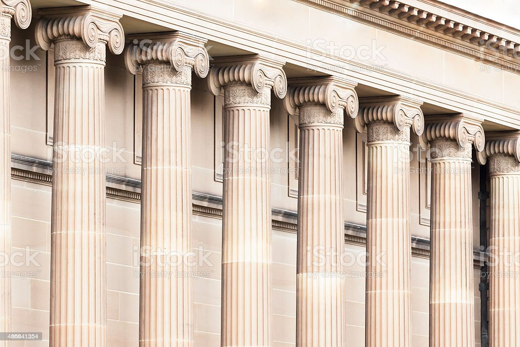 Row of classical columns, top part capital stock photo