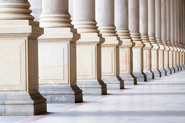 row of classical columns with copy space, czech republic - stability stock photos and pictures