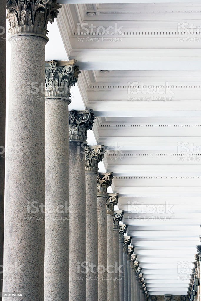 Row of classical stone columns stock photo