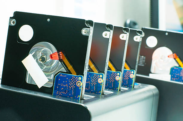 Row of clone harddisk drives in cloning dock stock photo