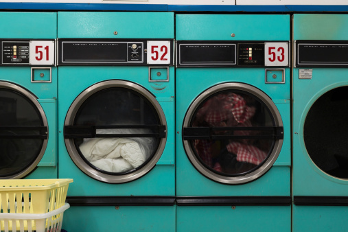 Row of Clothes Dryers - Laundromat