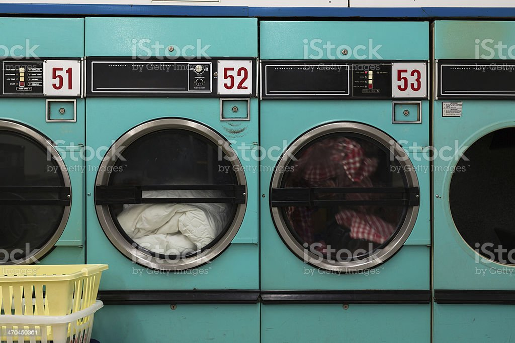 Row of Clothes Dryers - Laundromat stock photo