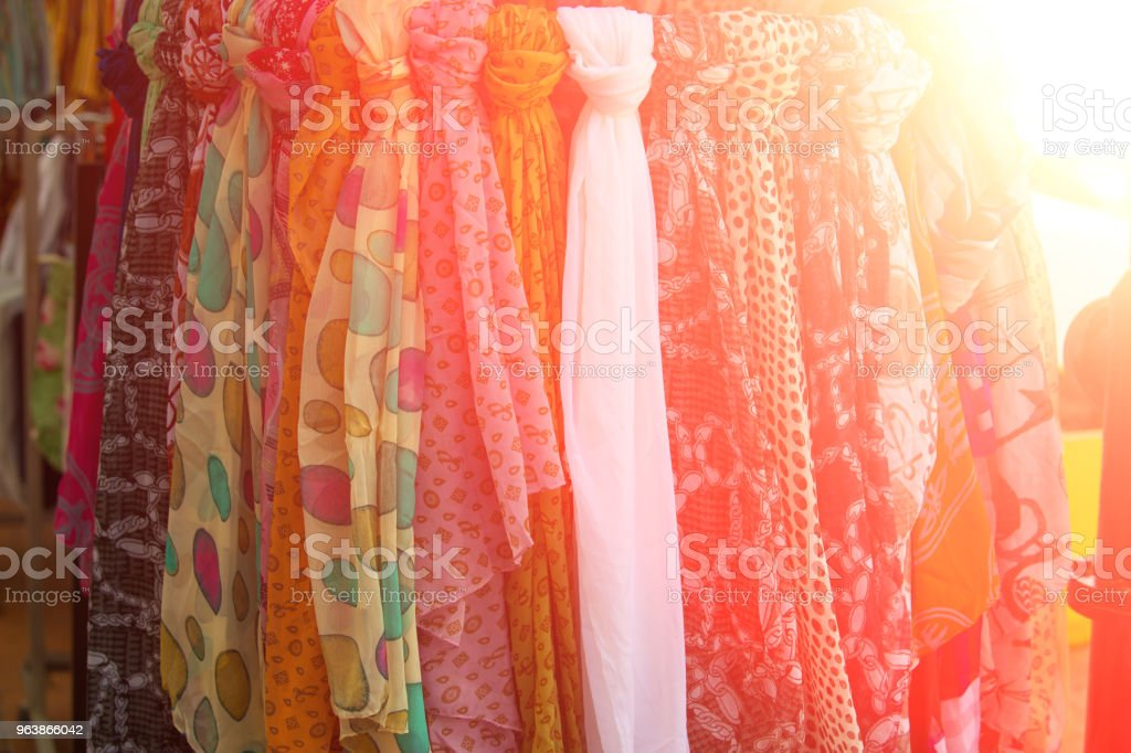 Row of clothes in outdoor shop, toned image - Royalty-free Business Stock Photo