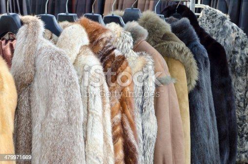 Row of coats made of animal fur