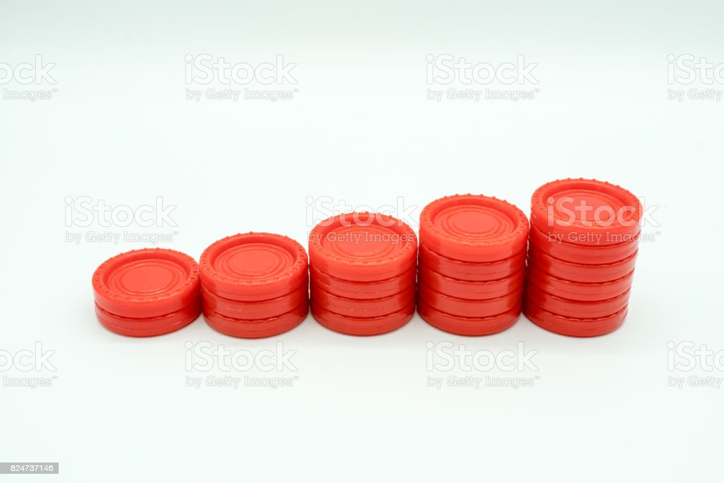 Row of coin rising stacks isolated on white stock photo