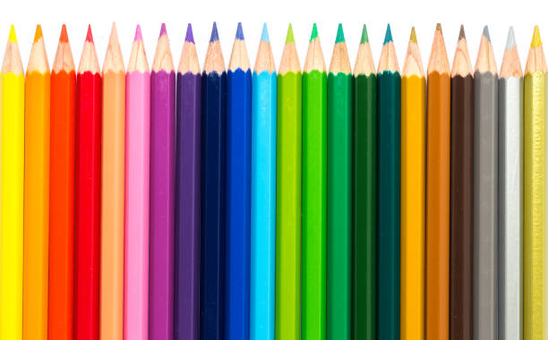 row of color pencil on white background. - coloured pencil stock photos and pictures