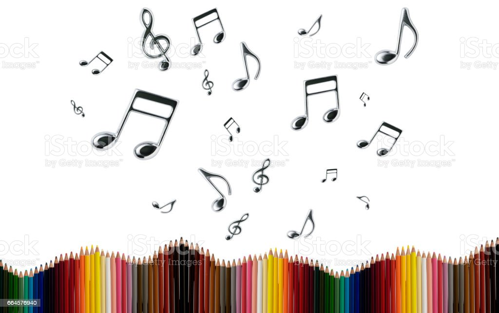 Row of colored pencils with flying musical notes against white background stock photo
