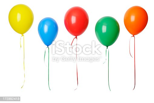 With CLIPPING PATH.Row of colorful balloons with ribbon isolated on a white background with clipping path.Studio shot.