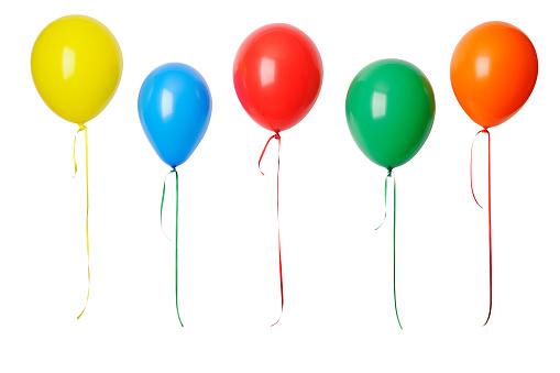 Row of colorful balloons in mid-air against white background