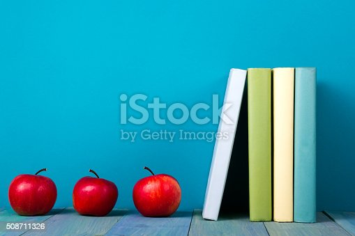 508711370 istock photo Row of colorful books, grungy blue background, free copy space 508711326