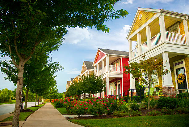 Row of colorful garden homes in suburban area Row of colorful garden homes with two stories and white pillars in suburban neighborhood of Fayetteville, Arkansas southern usa stock pictures, royalty-free photos & images
