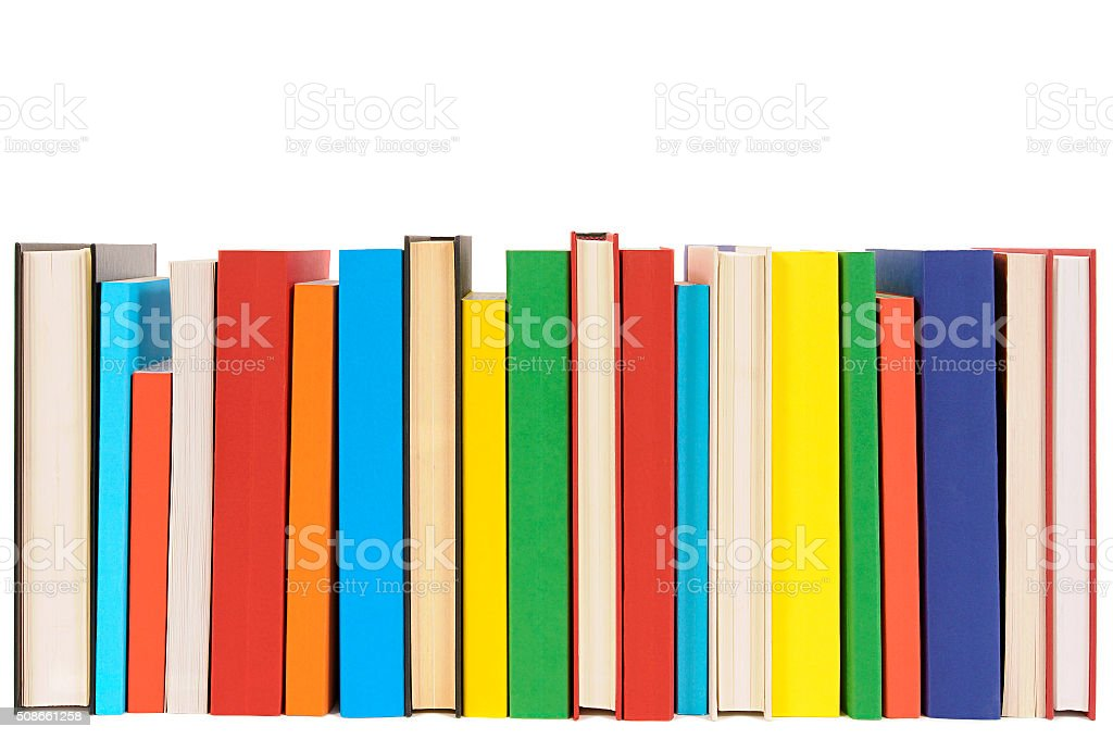 Row of colorful library books isolated on white background . stock photo