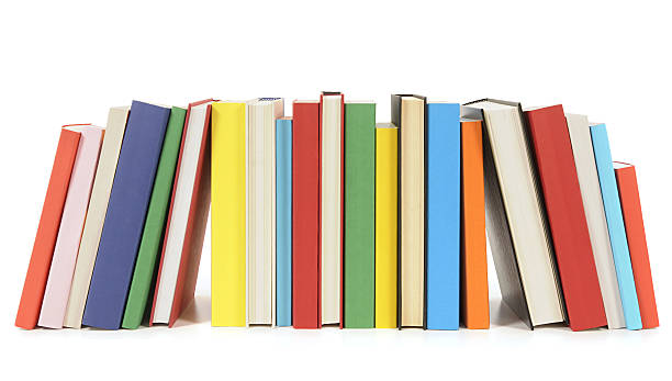 Row of colorful paperback books stock photo