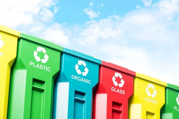 Row of colorful recycle bins and blue sky