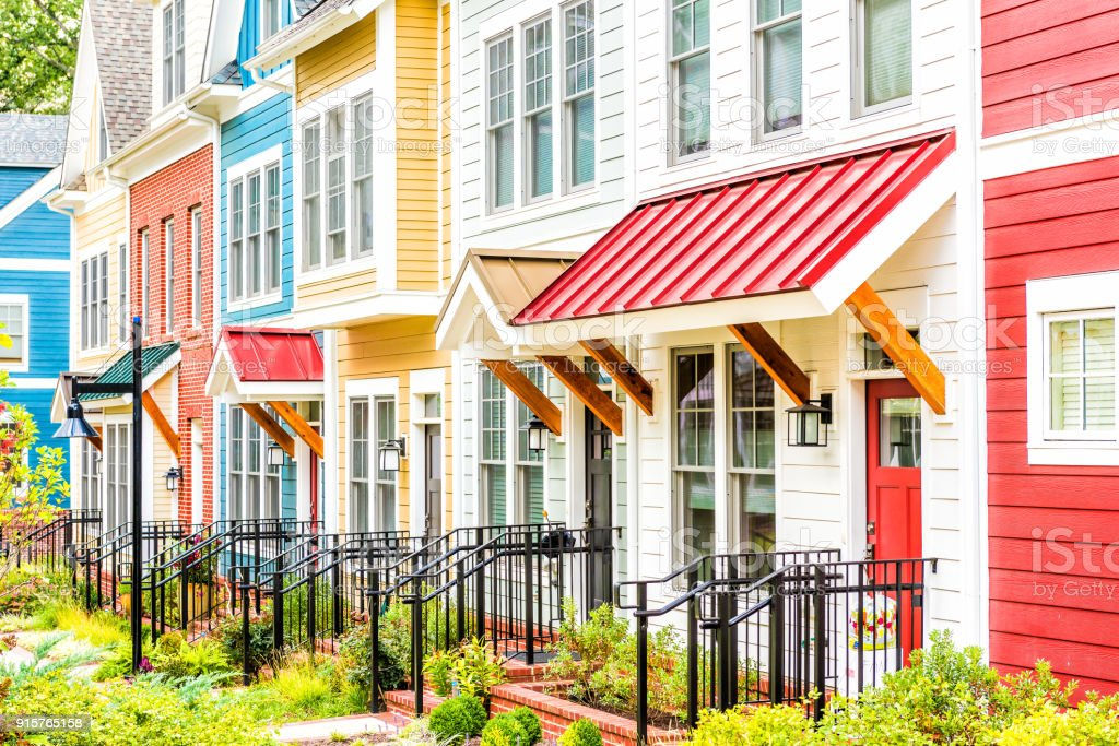 Row Of Colorful, Red, Yellow, Blue, White, Green Painted Residential  Townhouses