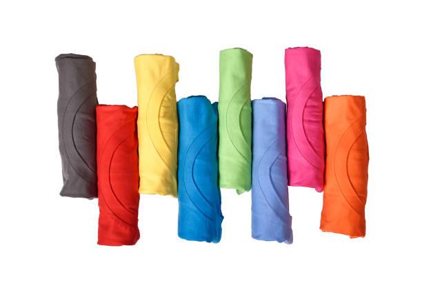 linha de roupas coloridas laminadas - cilindro - fotografias e filmes do acervo