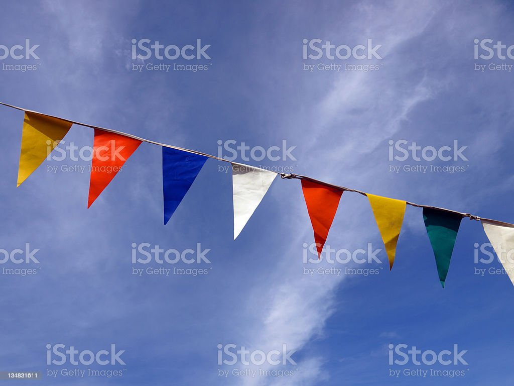 Row of coloured flags against the sky stock photo