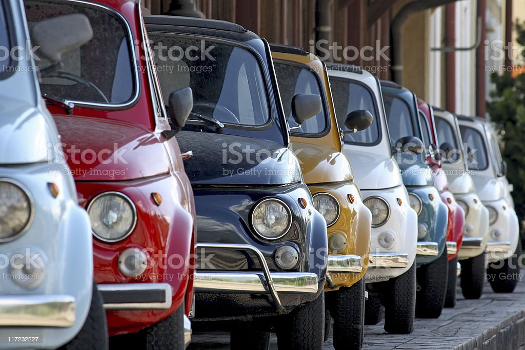 Row of coloured vintage italian cars stock photo
