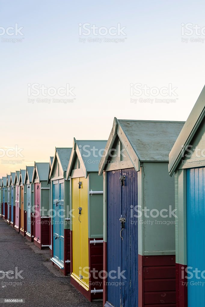 Row of colourful wooden beach huts stock photo