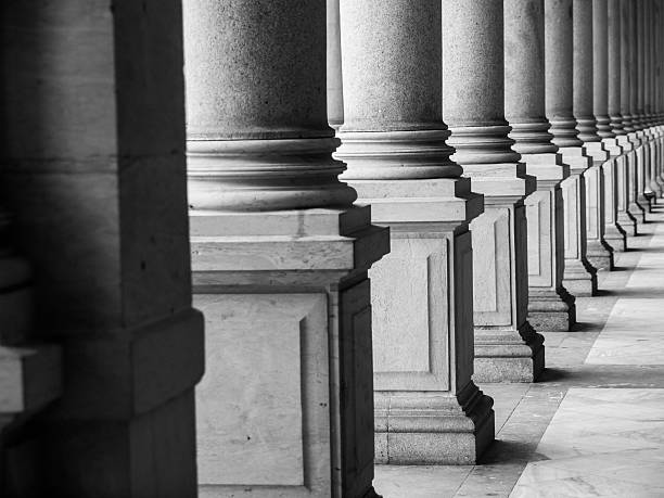 Row of columns in black and white stock photo