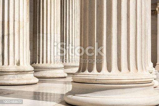 istock row of columns 1002489522
