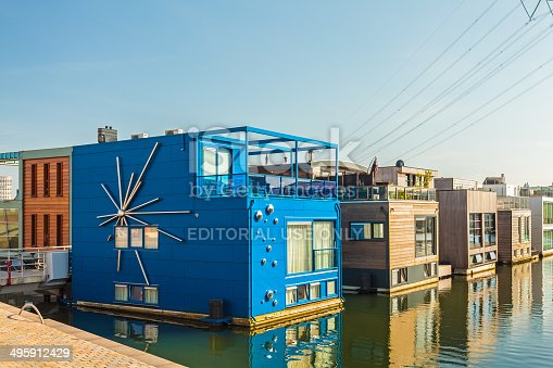 istock Row of contemporary house boats in Amsterdam 495912429