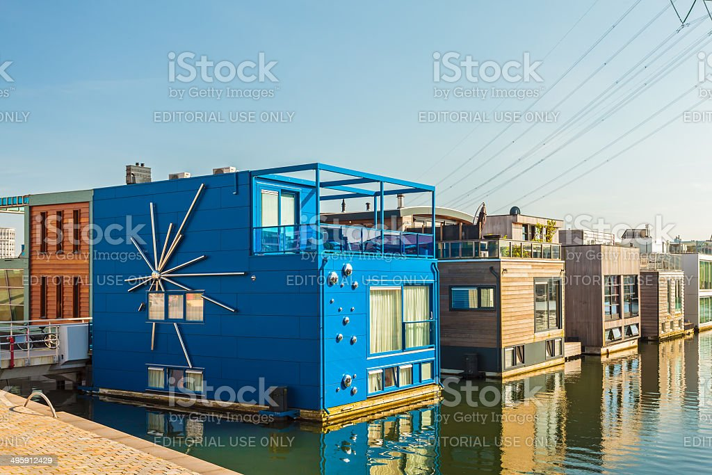 Row of contemporary house boats in Amsterdam stock photo