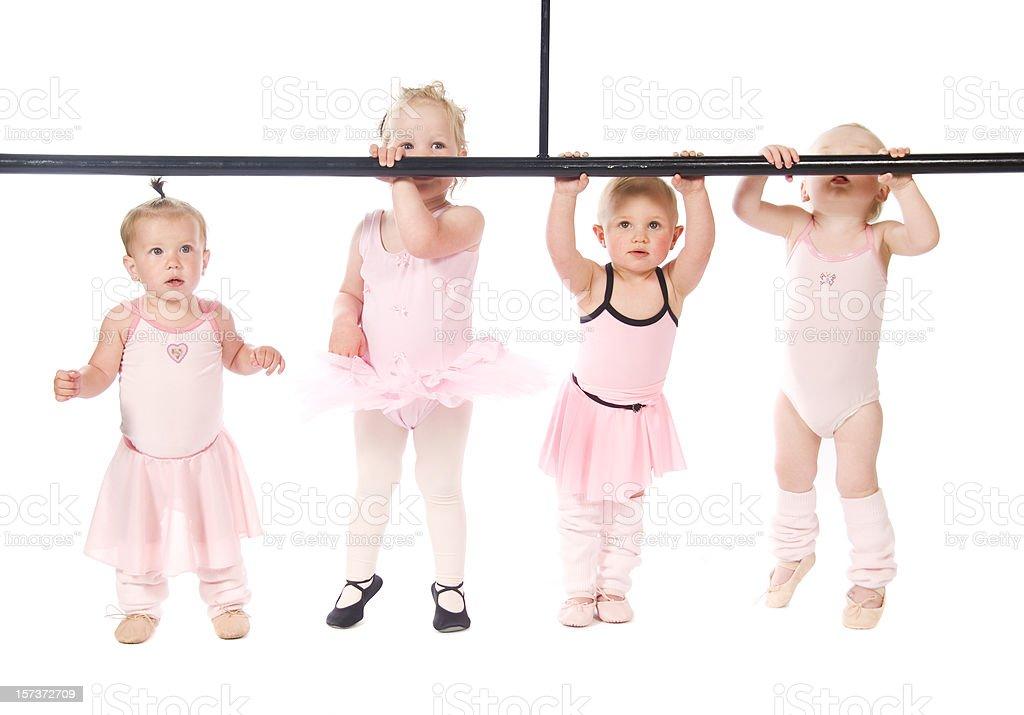 A row of cute baby dancers as ballerinas stock photo
