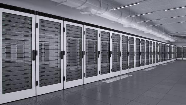 Row of data servers behind glass doors stock photo