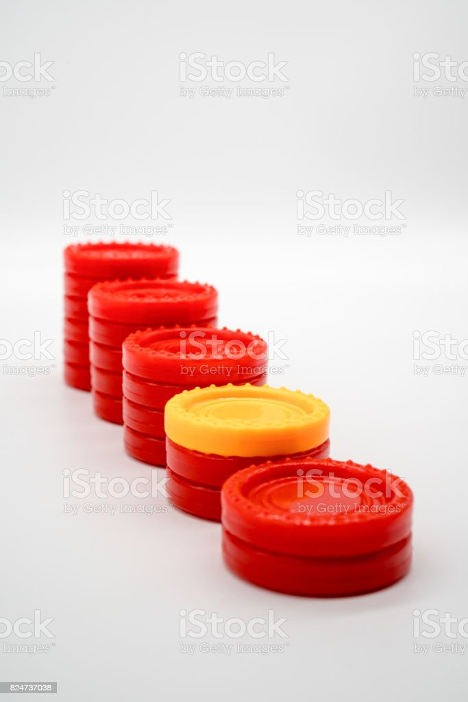 Row of different coin rising stacks isolated on white stock photo
